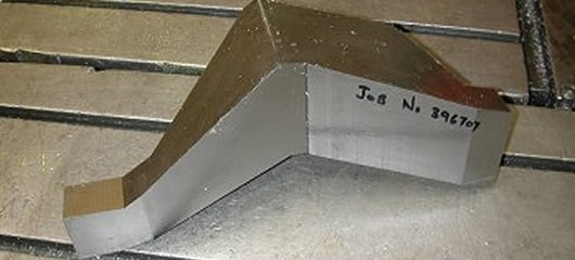 Titanium part cut from a block