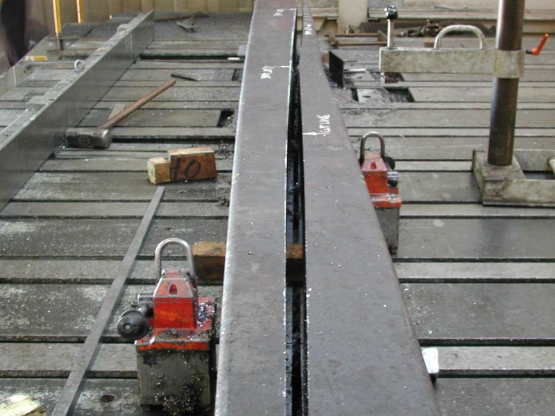 Manganese steel beam for rail points system
